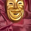 Stock Photo: Golden comedy theatrical mask
