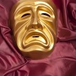 Golden tragedy theatrical mask — Stock Photo #26116435