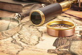 Brass telescope on map — Stock Photo
