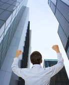 Businessman looking at a skyscraper — Stock Photo