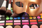 Makeup eye shadows and mask — Stock Photo