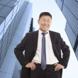 Happy asian businessman — Stock Photo