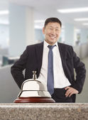 Asian hotel concierge — Stock Photo