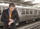 Businessman on a train station — Stock Photo