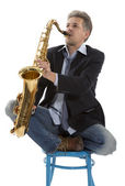 Saxophonist at sunset — Stock Photo