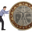 Businessman pushing euro coin  — Stock Photo