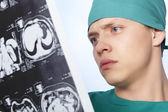 Doctor examines X-ray human brain — Stock Photo