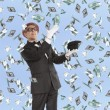 Businessman and flying dollar — Stock Photo