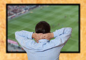 Man watching football game — Stock Photo