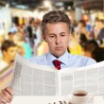 Businessman reading a newspaper — Stock Photo