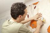 Decorator hanging wallpaper — Stock Photo