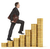 Businessman goes up gold coins — Stock Photo