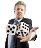 Man in a suit playing dice isolated — Stock Photo