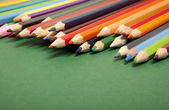 Color pencils on green background — Stock Photo