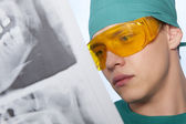 Dentist with jaw xray — Stock Photo