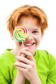 The red teenager with a sugar candy — Stock Photo