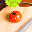 Tomato on hardboard — Stock Photo