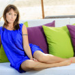 Woman sits back relaxed — Stock Photo #22263387