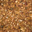 Structure of red clay with rocks — Stock Photo