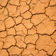 Stock Photo: Texture of crackled red clay