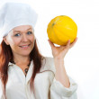 The woman shows a yellow melon — Stock Photo