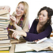 Stock Photo: Isolated on white two girls with books on the table