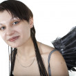 Smiling angel with grey wings on white — Stock Photo