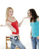 Harmonous girl treats the friend with cakes — Stock Photo