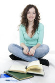 Single girl with glasses and books isolated on white — Stock Photo