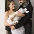 Young family with the baby at home — Stock Photo #33737581