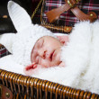 Sleeping baby in a suit of a rabbit — Stock Photo