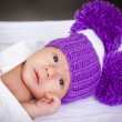 Stock Photo: Baby in violet knitted