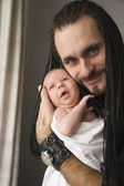 The young father embraces the baby — Stock Photo