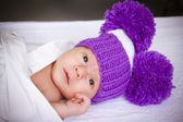 The baby in a violet knitted — Stock Photo