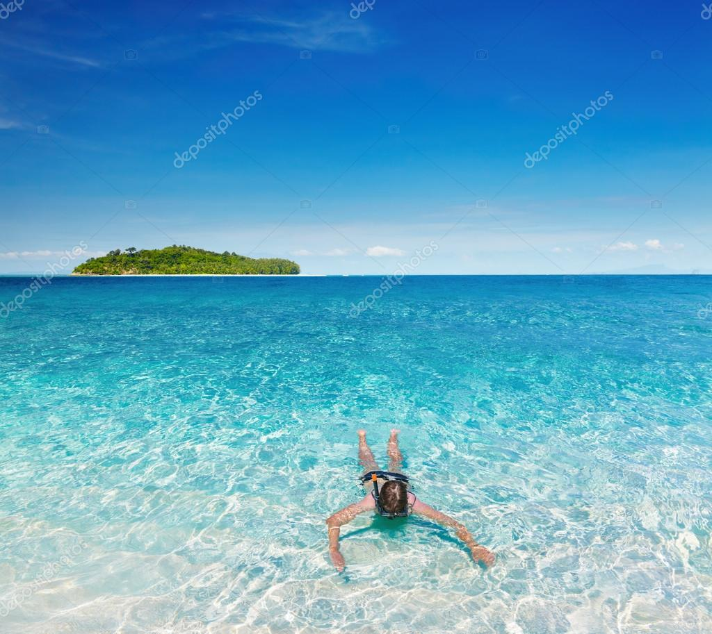 Woman swimming with snorkel, Andaman Sea, Thailand — Stock Photo #12794282