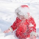 Toddler girl in snow — Stock Photo