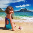 Small girl on the tropical beach - Stock Photo