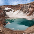 Acid lake in volcanic crater — Stock Photo
