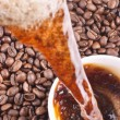 Stock Photo: Pouring coffee and coffee-beans