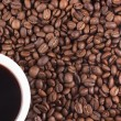 Stock Photo: Cup of coffee and coffee-beans