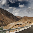 Stock Photo: Mountain road in Tibet