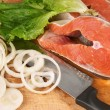 Stock Photo: Salmon pieces on cooking desk