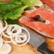 Salmon pieces on cooking desk — Stock Photo