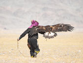 Eaglehunter with golden eagle — Stock Photo