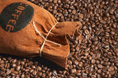Bag of coffee and coffee-beans — Stock Photo