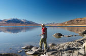 Fishing at a mountain lake — Stock Photo