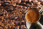 Turkish coffee-pot over coffee-beans and instant coffee background — Stock Photo