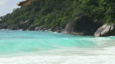 Andaman sea waves on Similan island shore.