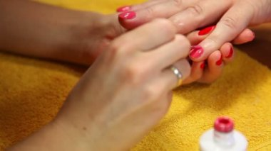 Painting fingernails with red polish — Stock Video