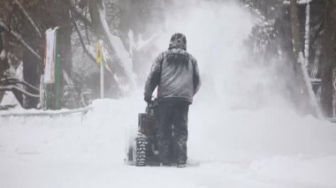 Man operating snow blower in winter — Stock Video